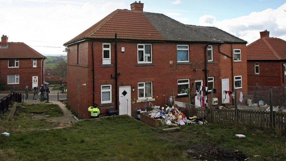 Police guard the home of Karen Matthews after her arrest