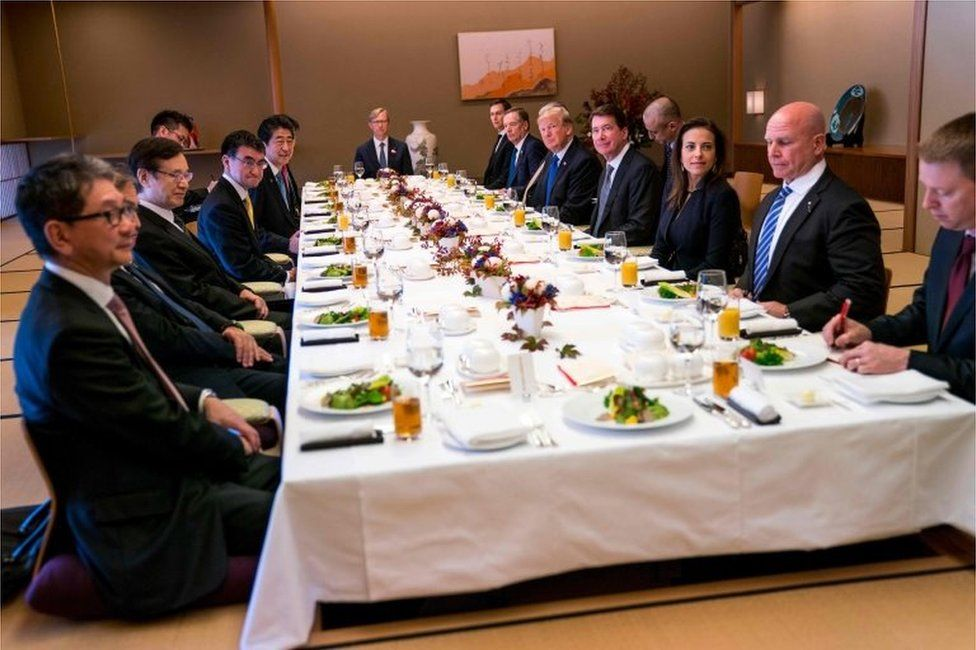 US President Donald Trump (5th R on table) and Japan's Prime Minister Shinzo Abe (5th L on table attend a working lunch at the Akasaka Palace in Tokyo on 6 November 2017.