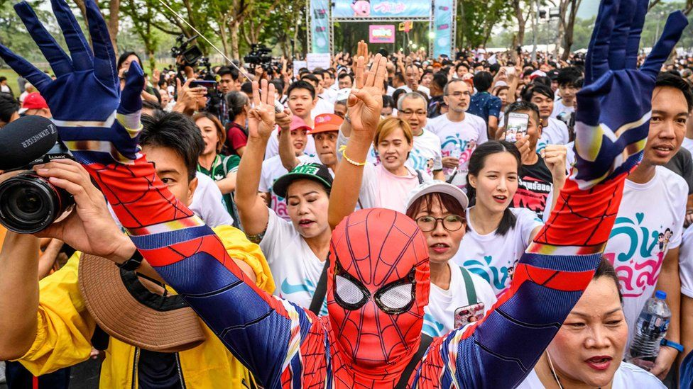 """A man dressed as Spider-Man takes part in a """"run against dictatorship"""" in Bangkok"""