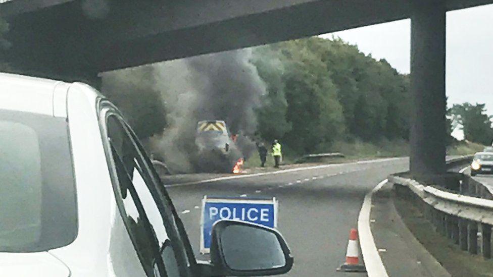 Van on fire on M90