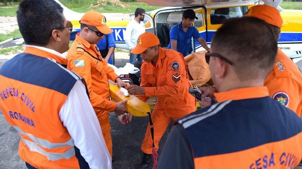 Picture shows rescue team preparing to search for pilot's body