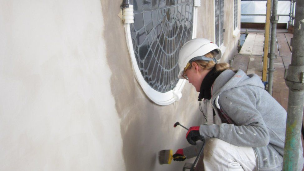 Sian McCarthy, painter for F A Valiant & Son Ltd, working at the Unitarian Meeting House
