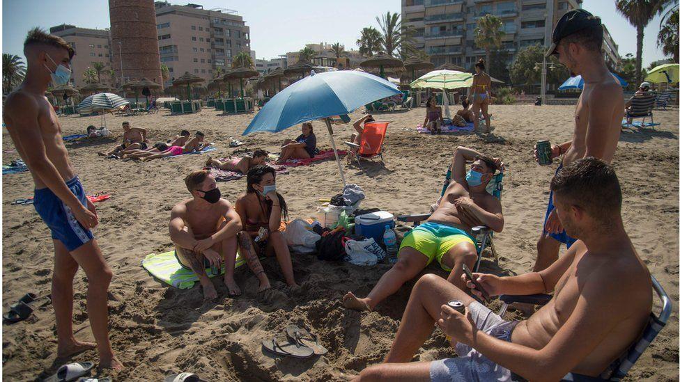 People on the beach in Malaga
