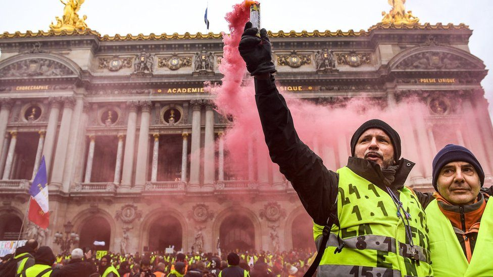 """Protesters gather at Place de l Opera during the """"yellow vests"""" demonstration on 15 December."""