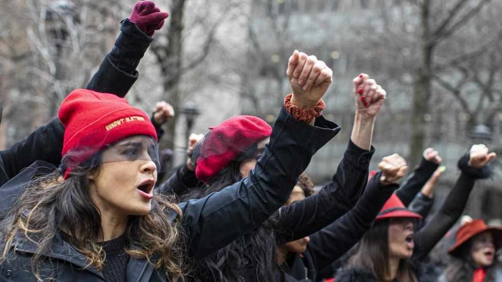 Women protest against rape as they sing a song in front of the court while Harvey Weinstein attends a pretrial session on January 10, 2020 in New York City