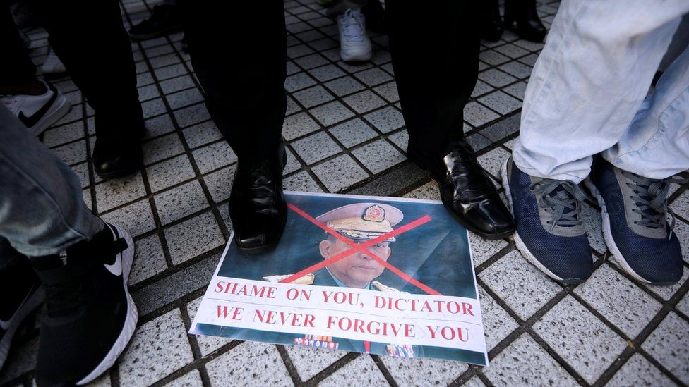 "Myanmar""s army chief Min Aung Hlaing""s picture lies on the ground, at a rally by expats living in Japan"