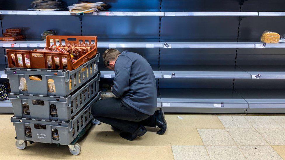 working restocking empty shelves