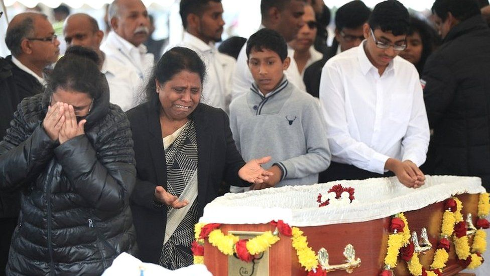 Mourners view the open coffin of Gurushanth Srithavarajah