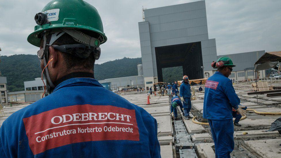worker in hard hat with Odebrecht logo on back of uniform