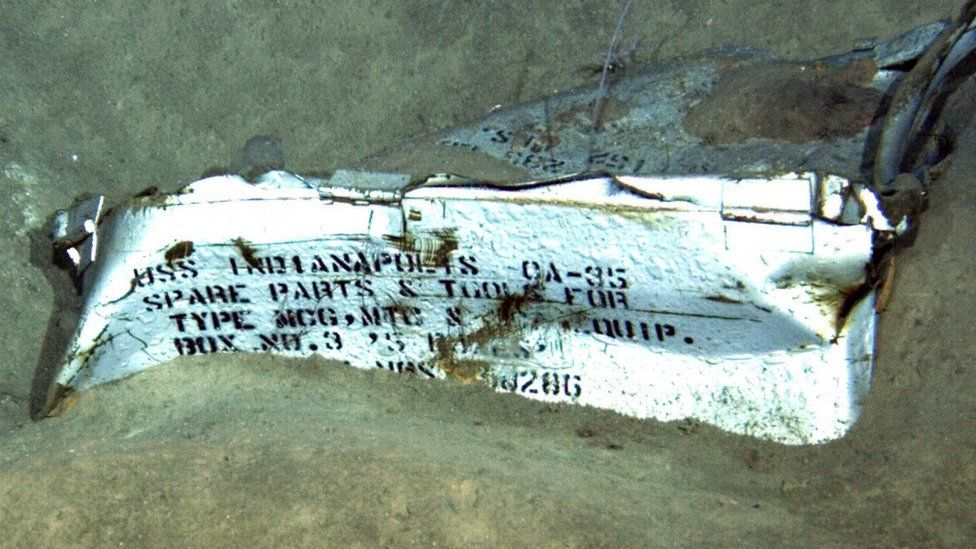A steel part showing the the text: USS Indianapolis, spare parts