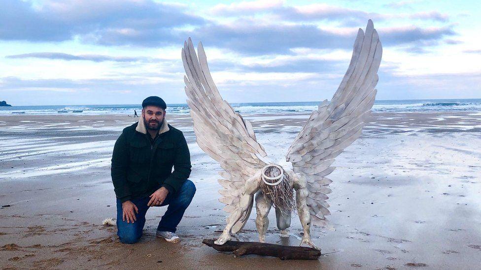 Brendan Rawlings with his angel statute.