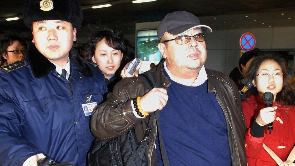 Kim Jong-nam wearing a leather jacket and baseball cap