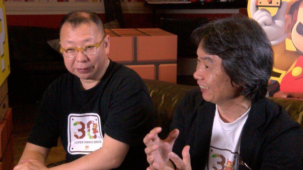 Shigeru Miyamoto and Takashi Tezuka sitting on a sofa