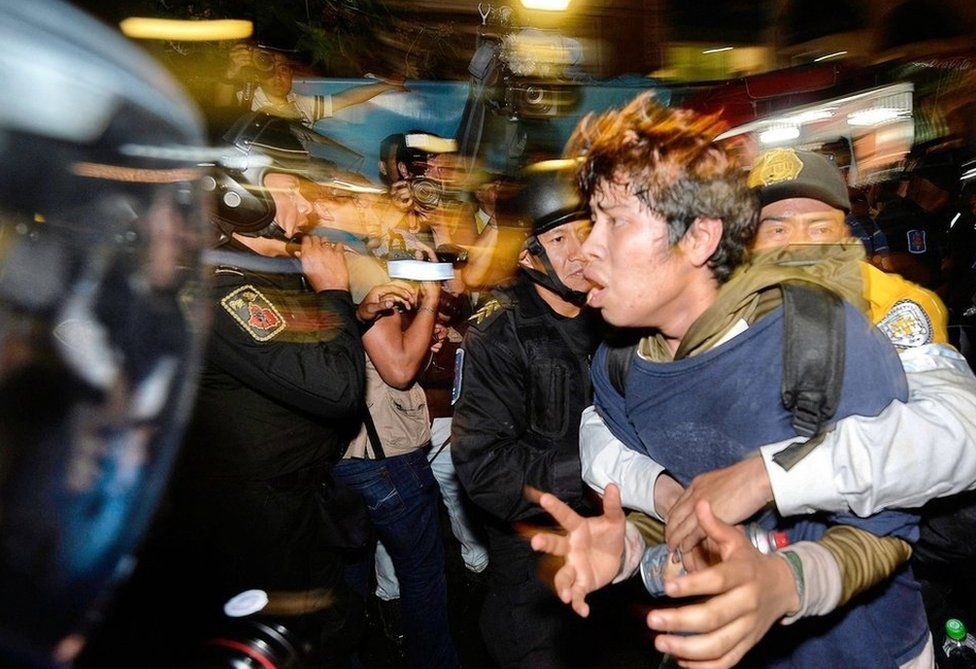 A student is arrested by police during a protest in Mexico City