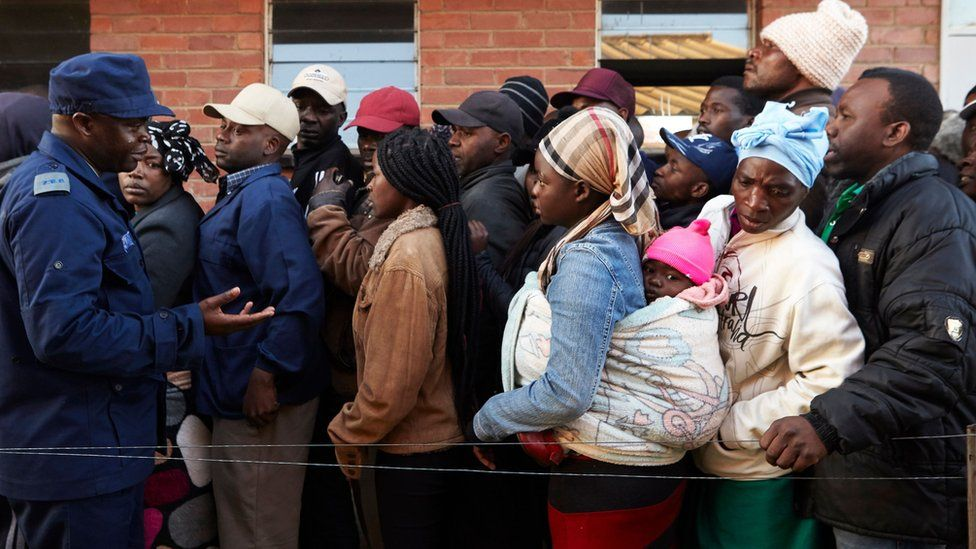 People queue early morning on 30 July 2018 at a polling station in the Harare suburb of Chitungwiza, Zimbabwe