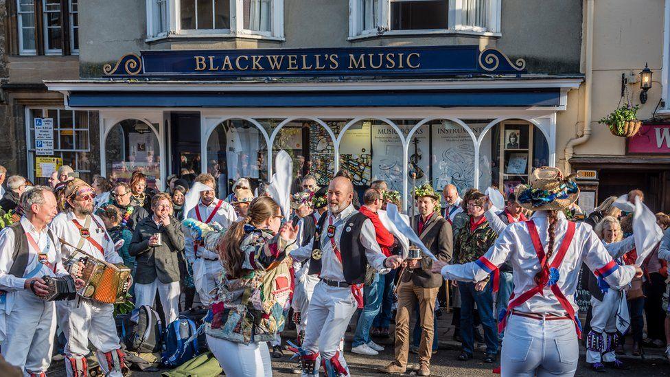 Morris men dancing outside Blackwells bookshop