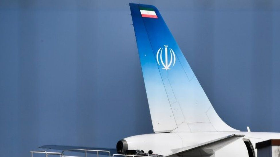"""The plane which carried Iran""""s Foreign Minister Mohammad Javad Zarif stands on the tarmac at the airport of the French seaside resort of Biarritz,"""