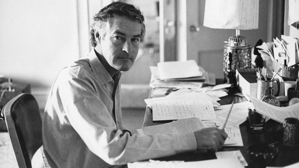 Timothy Leary at his desk