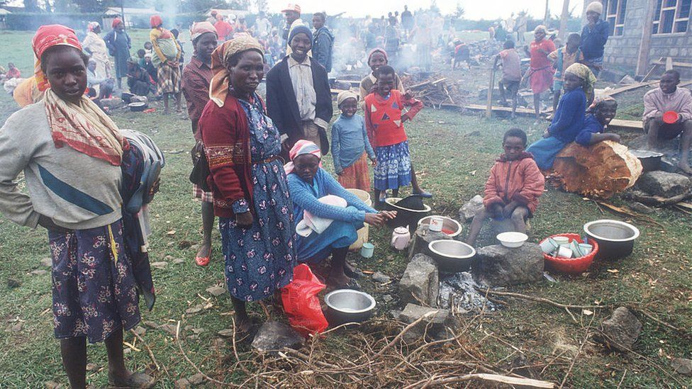 Women prepare a meal April 20, 1992 in Molo, Kenya. Incited by President Moi, followers of the ruling Kenyan African National Union attacked ethnic groups considered to support opposition leaders in the upcoming election, leaving hundreds dead and thousands displaced