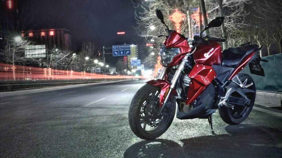 Evoke Urban S motorbike at night