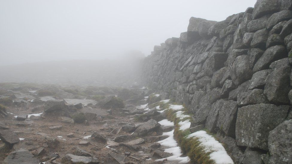 The Mourne Wall in the Mourne mountains covered in snow