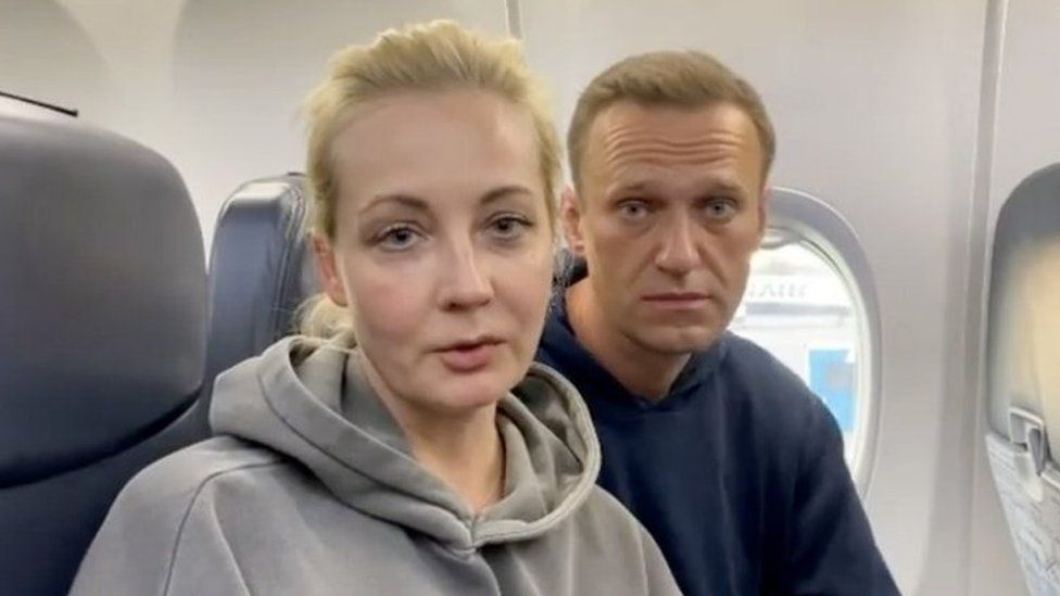 Alexei Navalny (right) and his wife Yulia on board a passenger plane in Berlin, Germany. Photo: 17 January 2021