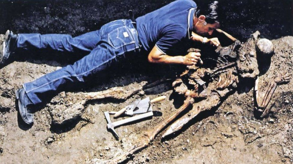 An archaeologist uncovers a skeleton at Herculaneum