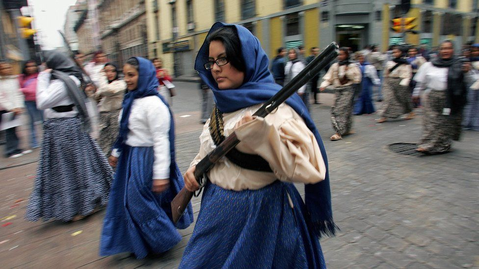 "Actresses clad as ""soldaderas"", soldier-women during the Mexican Revolution, take part in the parade commemorating the 96th anniversary of the Mexican Revolution"