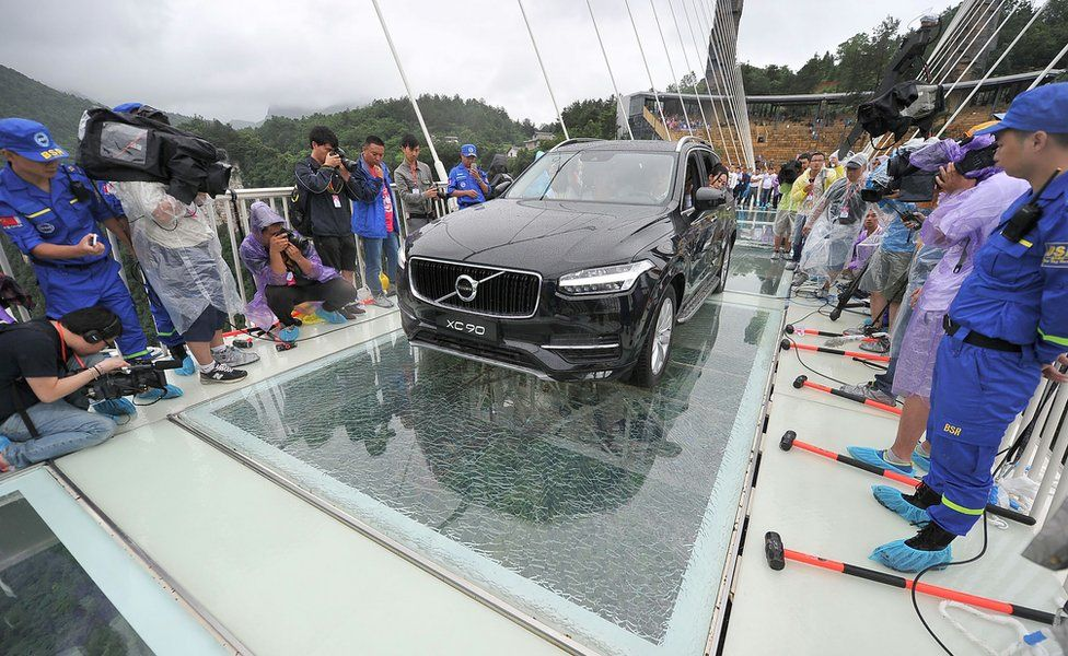A car is driven over a glass bridge in Zhangjiajie, (June 2016)