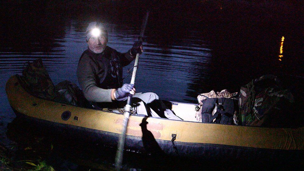 Peter Stanford in his canoe after sunset