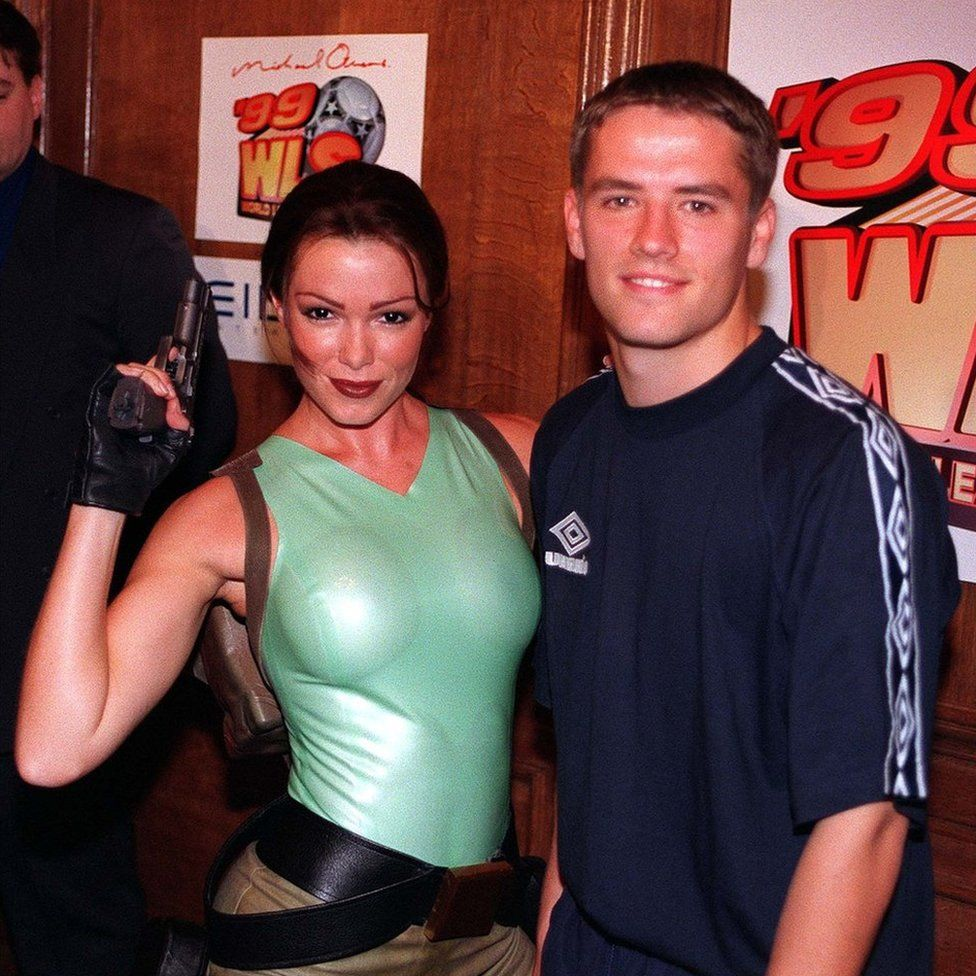 Footballer Michael Owen launched his computer game Michael Owen's World League Soccer 99 with model Nell McAndrew posing as Lara Croft, 6 September 1998
