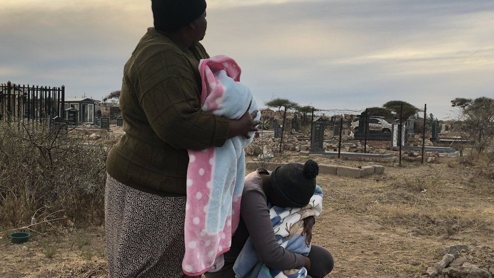 Kholofelo Moholola and her grandmother in a local cemetery