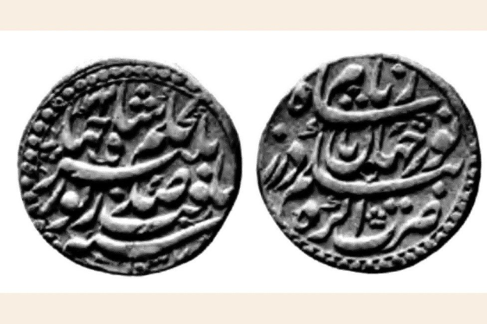 A silver coin with the names of Nur Jehan and Jenhagir