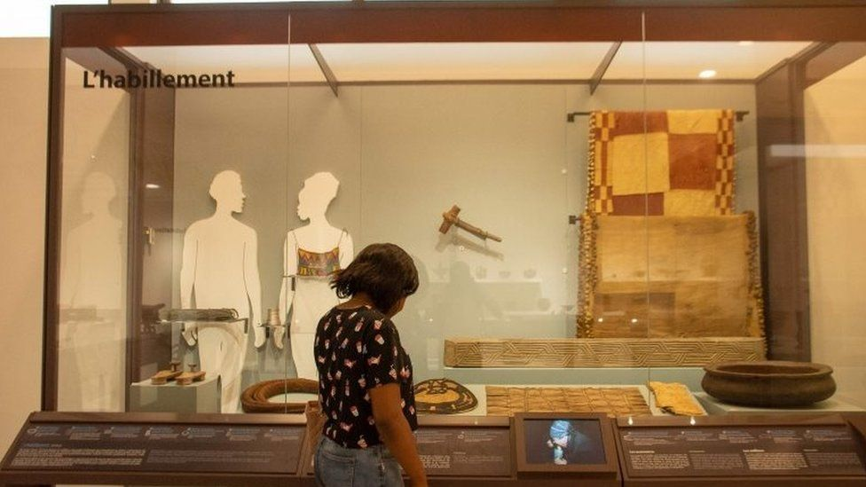 A woman looks at exhibit in new museum