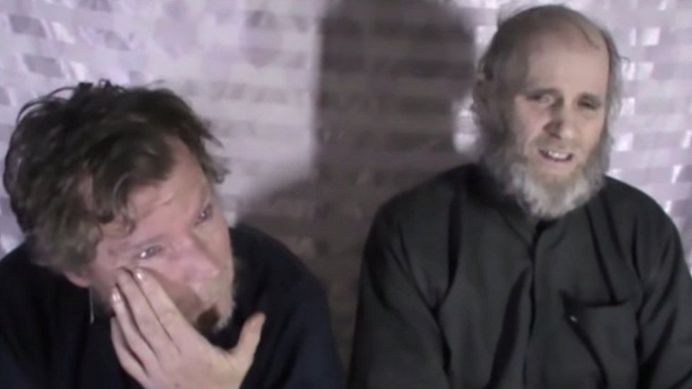 Mr Weeks (L) and fellow hostage Kevin King during their capture