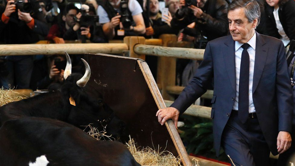 France's centre-right presidential candidate, Francois Fillon, visits a stall at Paris International Agriculture Fair on 1 March