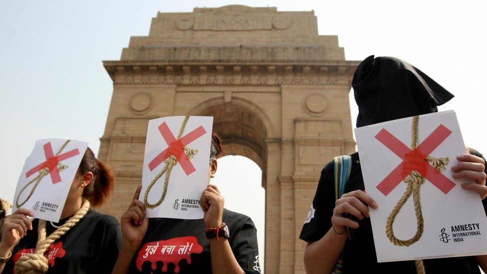 Activists of Amnesty International India wear black hoods and a noose around their necks as they protest against the death penalty, in New Delhi in October 2008