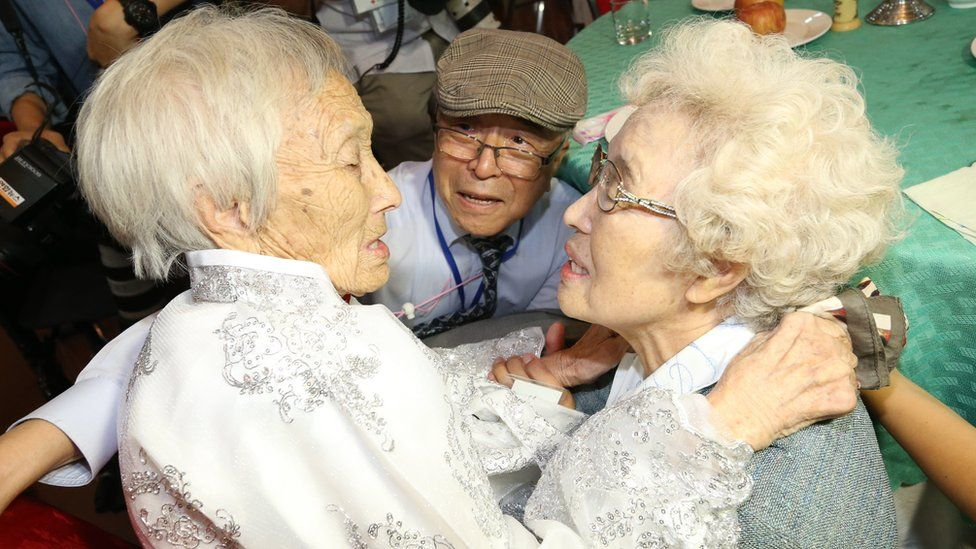 North Korean older sister Cho Sun-do (L), 89, meets with her South Korean younger sister Cho Hye-do (R), 86, and younger brother Cho Do-jae (C), 75, during the inter-Korean family reunions at the Mount Kumgang resort, North Korea, 20 August 2018