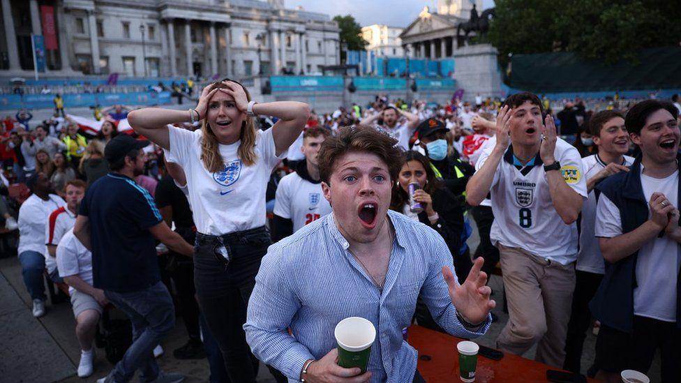 Fans gather in London ahead of Ukraine v England - London, Britain - July 3, 2021 England fans react in Trafalgar Square