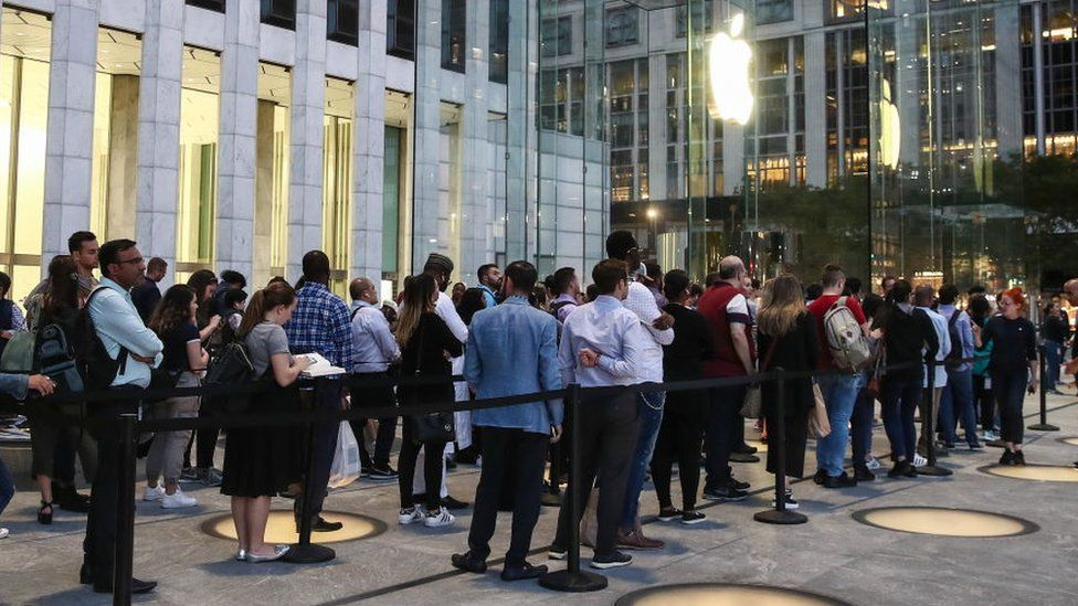 A queue outside Apple's 5th Avenue store in New York, September 2019