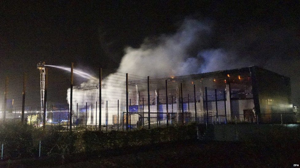 Firefighters try to extinguish a fire in the gym in Nauen, Germany, 25 August 2015
