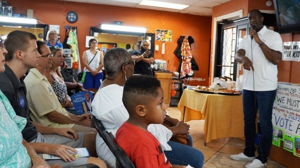 Andrew Gillum campaigns in a barbershop to become the governor of Florida