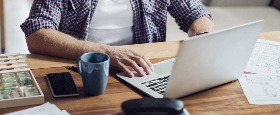 A man at a laptop