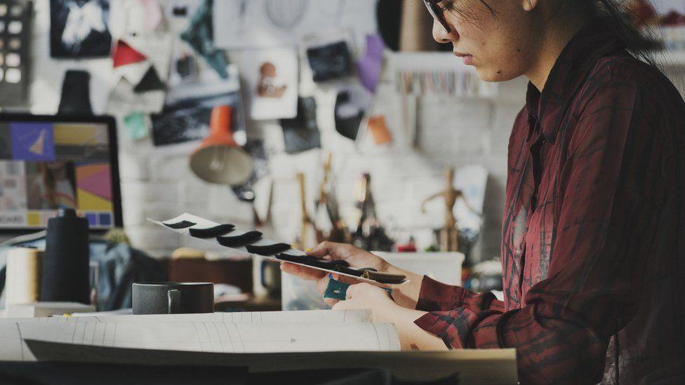 A textile designer in a studio