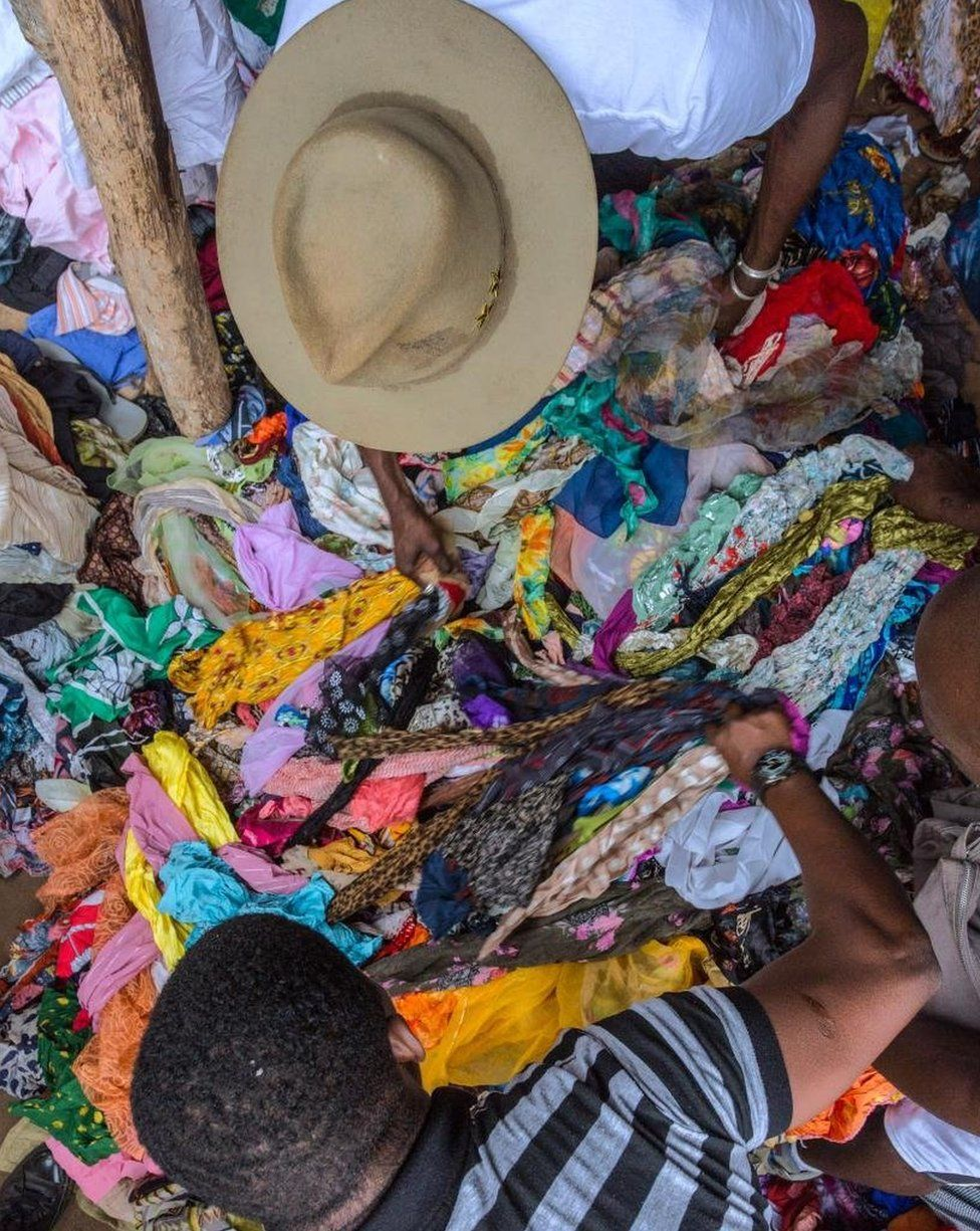 Amah selecting scarves at Hedzranawoe Market