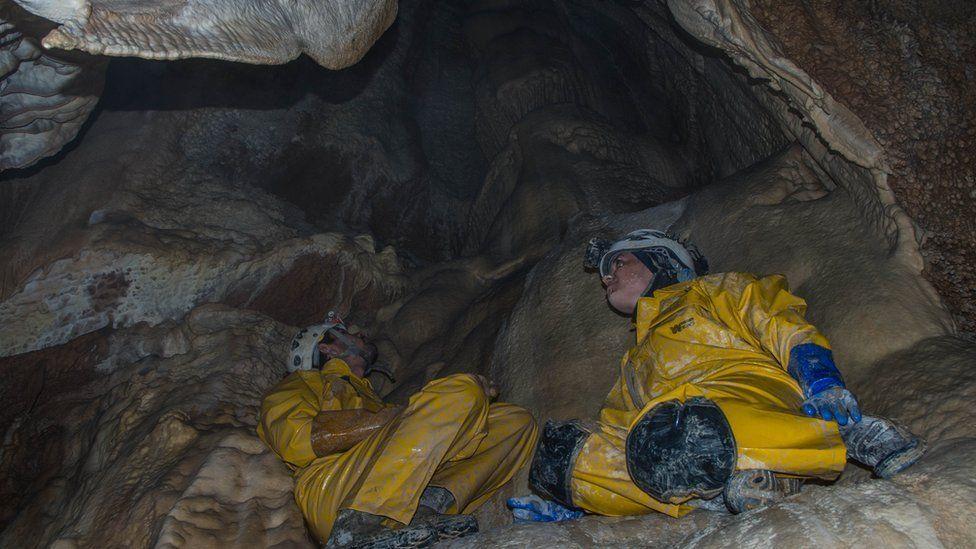 Two cavers inside Boybuloq