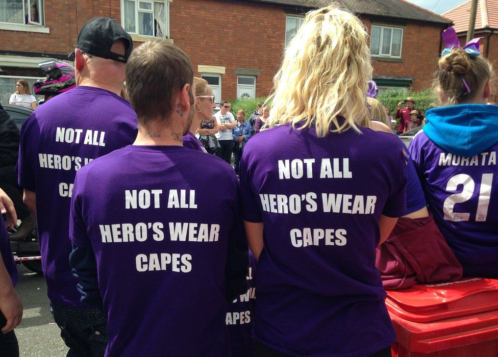 People wearing t-shirts in memory of Owen Jenkins