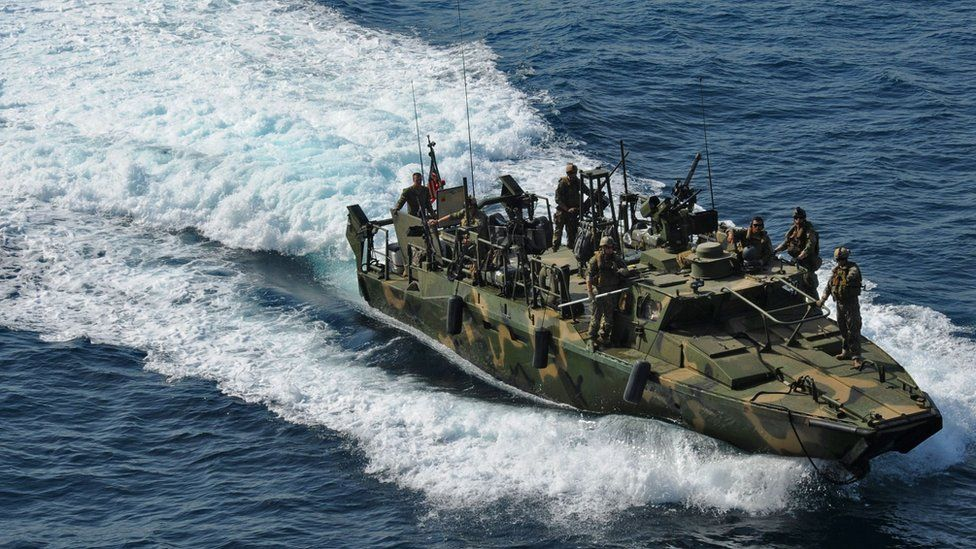 A US riverine patrol boat in action