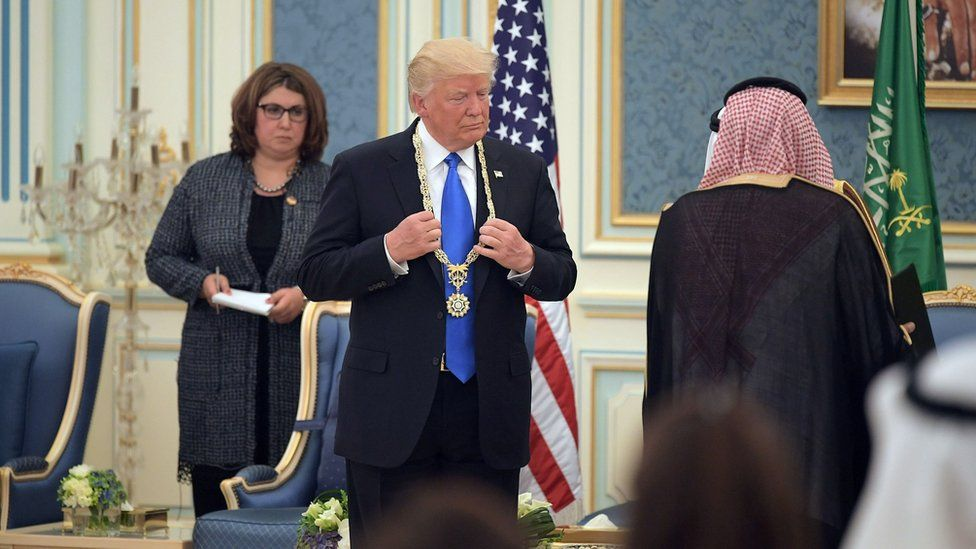 "US President Donald Trump (C) receives the Order of Abdulaziz al-Saud medal from Saudi Arabia""s King Salman bin Abdulaziz al-Saud"