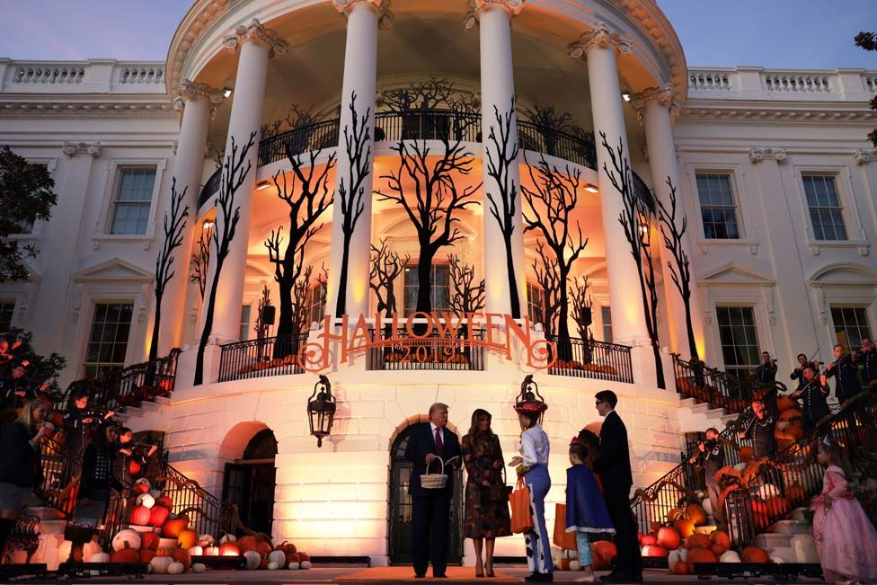 US President Donald Trump and First Lady Melania Trump handed out sweets in front of the White House